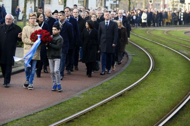 Sunday's ceremony included a silent march to the monument (AFP Photo/-)