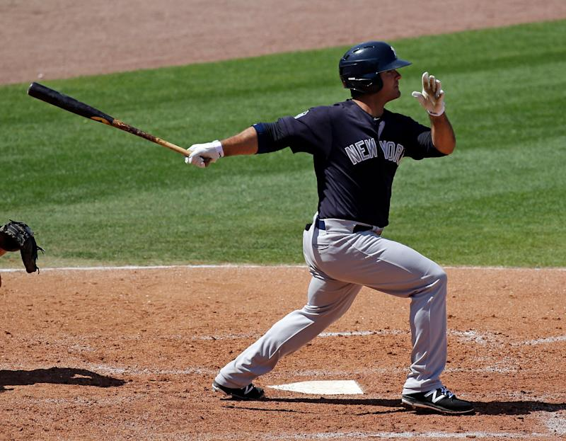 New York Yankees' Mike Ford hits a double against the Philadelphia Phillies in the sixth inning of a spring training baseball game, Thursday, March 30, 2017, in Clearwater, Fla. (AP Photo/John Raoux)
