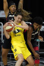 Seattle Storm forward Breanna Stewart (30) battles with Las Vegas Aces forward Angel McCoughtry (35) and forward Emma Cannon (32) for the ball during the first half of Game 1 of basketball's WNBA Finals Friday, Oct. 2, 2020, in Bradenton, Fla. (AP Photo/Chris O'Meara)