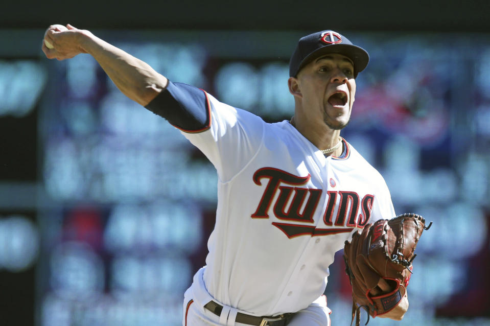 Minnesota Twins pitcher Jose Berrios throws against the Chicago White Sox during the first inning in the first game of a baseball doubleheader Friday, Sept. 28, 2018, in Minneapolis. (AP Photo/Jim Mone)