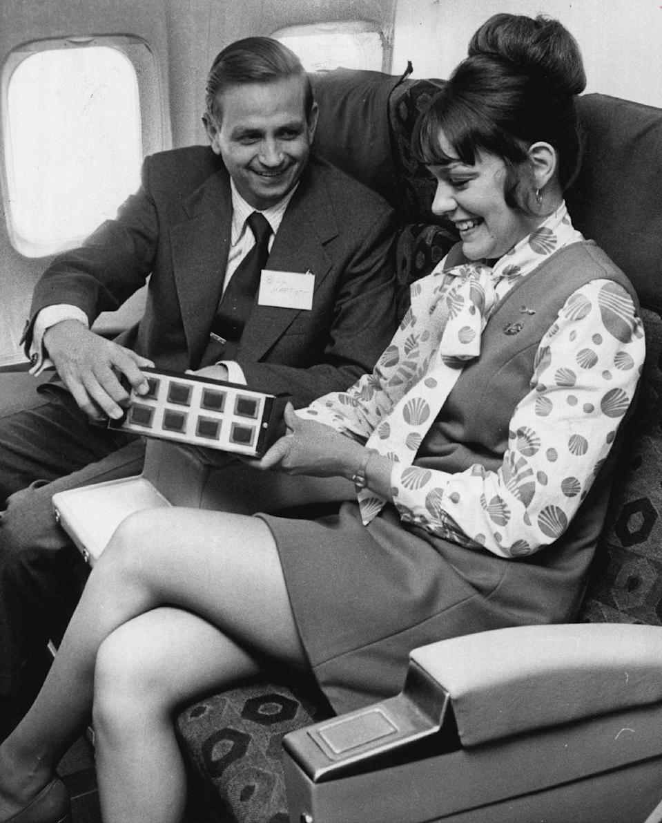 <p>J. Willard Marriott, president of the eponymous hotel chain, smiles with the flight attendant on a flight in 1973.</p>