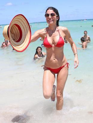 Bethenny Frankel looks incredible in a red bikini as she hits the beach in Miami, Aug. 13, 2013