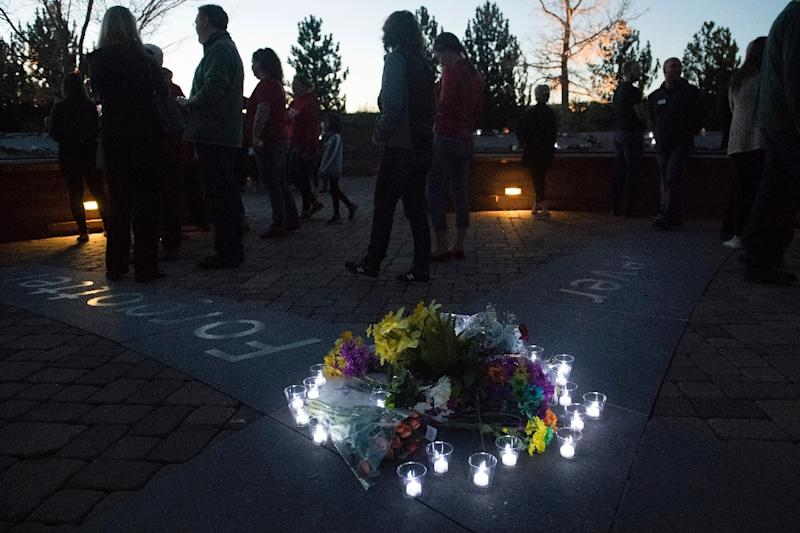 Candles encircle a collection of flowers at the Columbine memorial (AFP Photo/Jason Connolly)