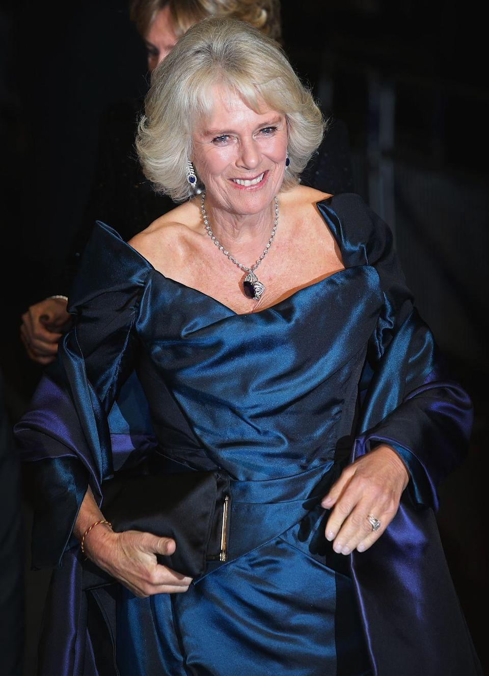 <p>Camilla wore this large floral sapphire and diamond pendant to a 2013 performance in London. </p>