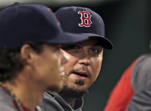 Boston Red Sox pitcher Josh Beckett, right, talks with Clay Buchholz during the fifth inning of a baseball game against the Los Angeles Angels at Fenway Park in Boston, Thursday, Aug. 23, 2012. (AP Photo/Charles Krupa)