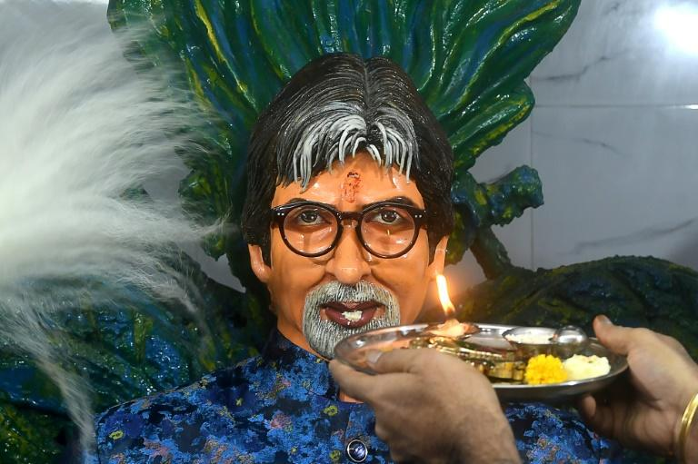A fan makes an offering to a statue of Bollywood actor Amitabh Bachchan at a temple named after him in Kolkata