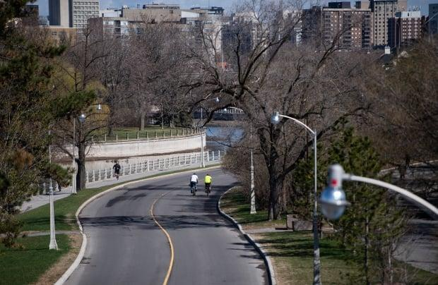 Cyclists ride along Colonel By Drive on Sunday, May 3, 2020. A five-kilometre stretch of the roadway will be completely closed to vehicular traffic this summer, the NCC announced Friday. (Justin Tang/Canadian Press - image credit)