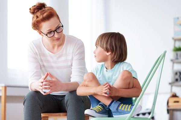 'Gaze Aversion' Helps Us And Our Kids Process Information And Reduce Stress: Young female having serious conversation with little boy