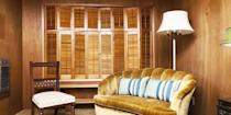 <p>It might have been fabulous in the 70s, but in 2019, avoid wood paneling at all costs. It typically makes a room look dreary and dated, and nobody should settle for this type of environment. </p>