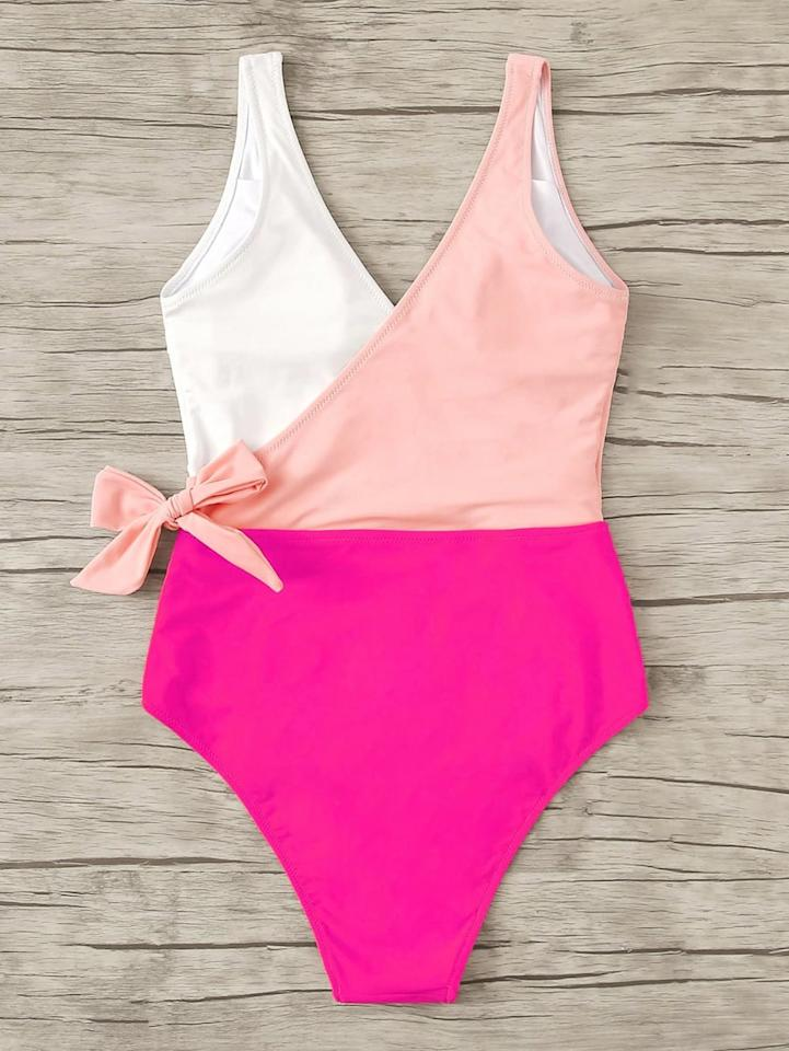 """<p><a href=""""https://www.popsugar.com/buy/Shein-Colorblock-Surplice-Neck-One-Piece-Swimsuit-584728?p_name=Shein%20Colorblock%20Surplice%20Neck%20One-Piece%20Swimsuit&retailer=us.shein.com&pid=584728&price=9&evar1=fab%3Aus&evar9=47573899&evar98=https%3A%2F%2Fwww.popsugar.com%2Fphoto-gallery%2F47573899%2Fimage%2F47573911%2FShein-Colorblock-Surplice-Neck-One-Piece-Swimsuit&list1=swimwear%2Cone-piece%20swimsuits%2Cproduct%20reviews%2Csummer%20fashion%2Cshein%2Caffordable%20shopping%2Ccheap%20obsessions&prop13=api&pdata=1"""" rel=""""nofollow"""" data-shoppable-link=""""1"""" target=""""_blank"""" class=""""ga-track"""" data-ga-category=""""Related"""" data-ga-label=""""https://us.shein.com/Colorblock-Surplice-Neck-One-Piece-Swimsuit-p-775305-cat-2193.html?scici=Search~~EditSearch~~1~~one-piece%20swimsuit%20wrap~~~~0~~0"""" data-ga-action=""""In-Line Links"""">Shein Colorblock Surplice Neck One-Piece Swimsuit</a> ($9, originally $13)</p>"""
