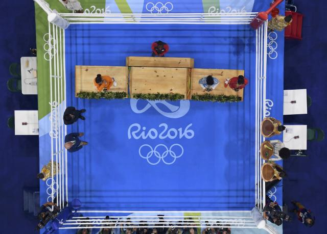 2016 Rio Olympics - Boxing - Victory Ceremony - Women's Middle (75kg) Victory Ceremony - Riocentro - Pavilion 6 - Rio de Janeiro, Brazil - 21/08/2016. Gold medallist Claressa Shields (USA) of USA waits to get on the podium alongside (from L) silver medallist Nouchka Fontijn (NED) of Netherlands, and bronze medallists Dariga Shakimova (KAZ) of Kazakhstan and Li Qian (CHN) of China. REUTERS/Pool FOR EDITORIAL USE ONLY. NOT FOR SALE FOR MARKETING OR ADVERTISING CAMPAIGNS.