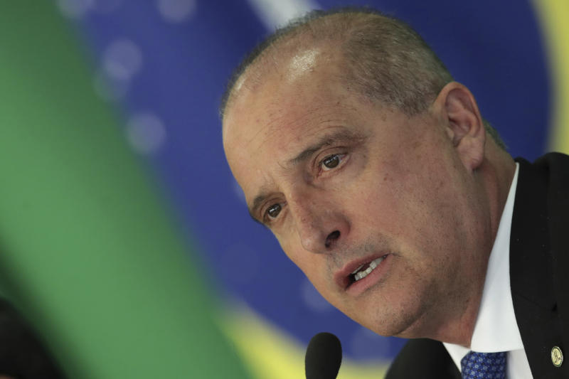 Chief of Staff Onyx Lorenzoni speaks during a press conference regarding a potential truckers' strike, at the Planalto Presidential Palace, in Brasilia, Brazil, Tuesday, April 16, 2019. The government of Brazilian President Jair Bolsonaro has announced a financial package aimed at staving off a potential truckers' strike. (AP Photo/Eraldo Peres)