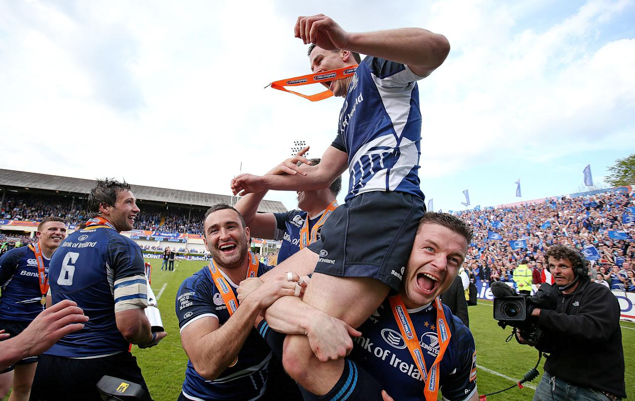 Leinster's Jonny Sexton is lifted by Dave Carney (left), Devin Toner and Brian O'Driscoll (right) as they celebrate during the RaboDirect PRO12 Final at the RDS, Dublin, Ireland.