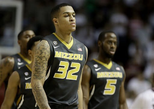 Missouri's Jabari Brown (32) leads teammates off the court during a time out against Texas A&M during the second half of an NCAA college basketball game on Thursday, Feb. 7, 2013, in College Station, Texas. Texas A&M won 70-68. (AP Photo/Pat Sullivan)