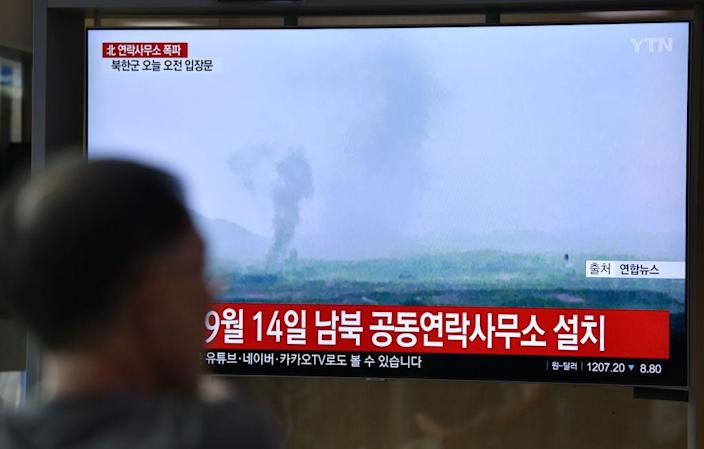 A television news program in Seoul shows the demolition of an inter-Korean liaison office in North Korea's Kaesong Industrial Complex on June 16, 2020.