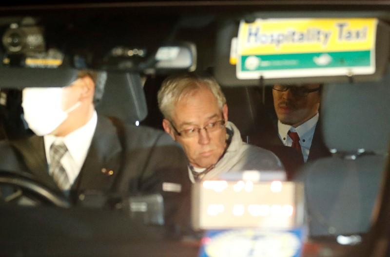 FILE PHOTO: Greg Kelly, the former deputy of ousted Nissan chairman Carlos Ghosn, is seen in the car, as he leaves after being released from a detention centre in Tokyo