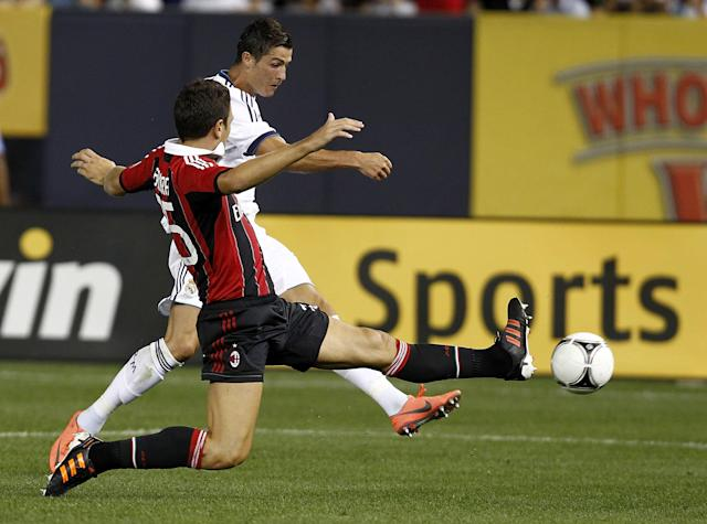 NEW YORK - AUGUST 08: Cristiano Ronaldo #7 of Real Madrid scores a goal past Daniele Bonera #25 of A.C. Milan during their match at Yankee Stadium on August 8, 2012 in New York City. (Photo by Jeff Zelevansky/Getty Images)