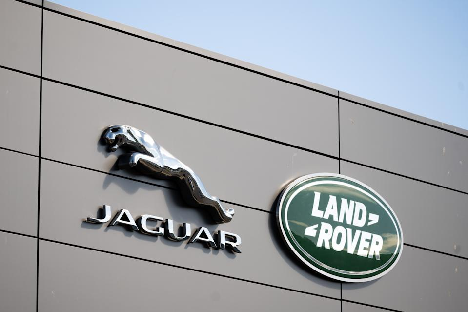CARDIFF, WALES - JULY 22: A close-up of a Jaguar Land Rover sign at a car garage on July 22, 2020 in Cardiff, Wales. Many UK businesses are announcing job losses due to the effects of the coronavirus pandemic and lockdown. (Photo by Matthew Horwood/Getty Images)