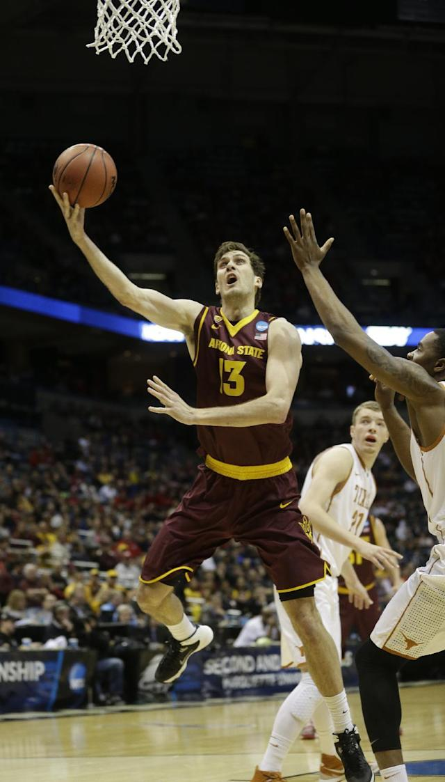 Arizona State center Jordan Bachynski (13) drives to the basket during the first half of a second round NCAA college basketball tournament game against the Texas Thursday, March 20, 2014, in Milwaukee. (AP Photo/Morry Gash)