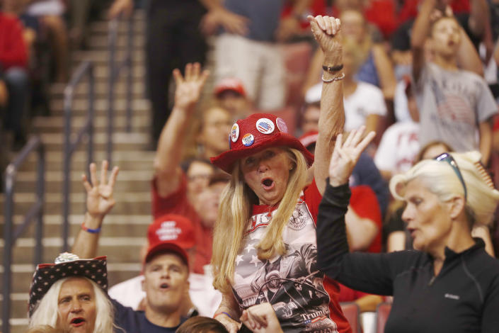 Supports cheer before President Donald Trump's rally on Tuesday, Nov. 26, 2019, in Sunrise, Fla. (AP Photo/Brynn Anderson)