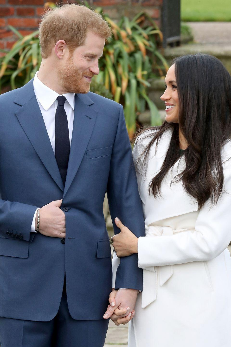 <p>With no other public appearances until late November, Prince Harry and Markle were next photographed together during an official photo-call to announce their engagement. In front of the Sunken Garden at Kensington Palace in London, the bride-to-be held tight to her fiancé's arm and flashed a smile.</p>