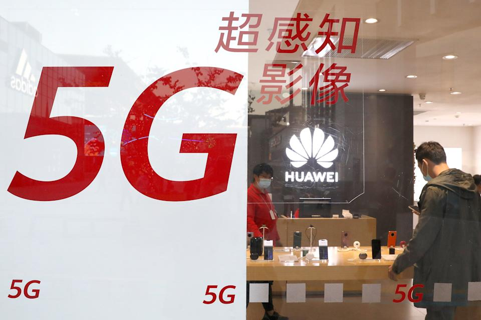 BEIJING, CHINA - OCTOBER 12: The Huawei logo and 5G sign are seen at a Huawei store on October 12, 2020 in Beijng, China. (Photo by VCG/VCG via Getty Images)