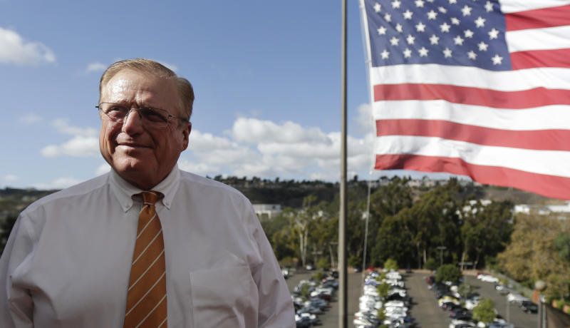 """In this photo taken Oct. 10, 2012, John Lynch, CEO of the U-T San Diego newspaper, poses for a picture outside his office in San Diego. Lynch and his partner Douglas Manchester gave their 143-year-old newspaper a new slogan — """"The World's Greatest Country & America's Finest City"""" — ran a front-page editorial that declared their plan to reshape the city's downtown waterfront their highest priority, and forecast doom if President Barack Obama wins re-election. (AP Photo/Gregory Bull)"""