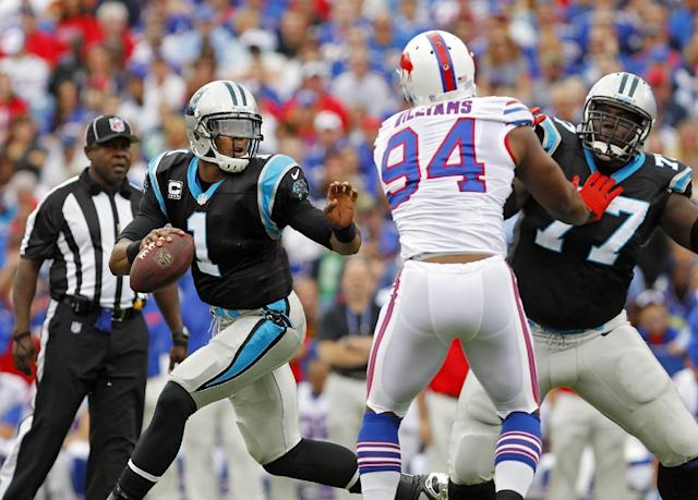 Carolina Panthers quarterback Cam Newton (1) scrambles away from Buffalo Bills defensive end Mario Williams (94) as Byron Bell (77) blocks in the first quarter of an NFL football game Sunday, Sept. 15, 2013, in Orchard Park, N.Y. (AP Photo/Bill Wippert)