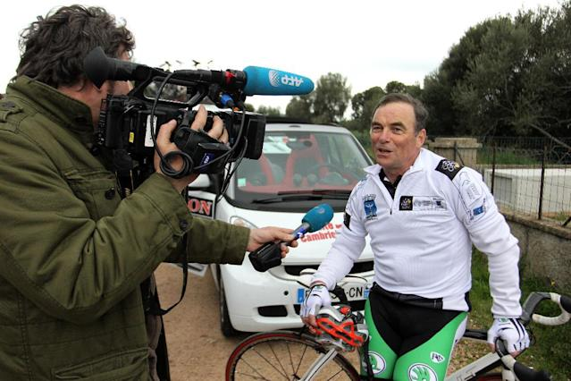Bernard Hinault, French cycling legend and member of the directory board of the Tour de France race, answers a journalist's questions in Bonifacio, on the French Mediterranean island of Corsica, on March 22, 2013 (AFP Photo/Pascal Pochard-Casabianca)