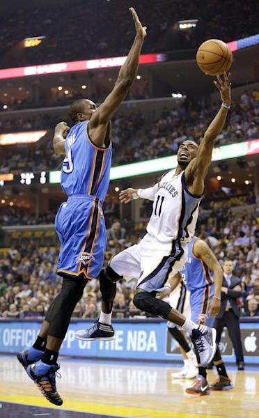Memphis Grizzlies guard Mike Conley (11) drives against Oklahoma City Thunder forward Serge Ibaka (9) in the first half of Game 6 of an opening-round NBA basketball playoff series Thursday, May 1, 2014, in Memphis, Tenn. (AP Photo/Mark Humphrey)