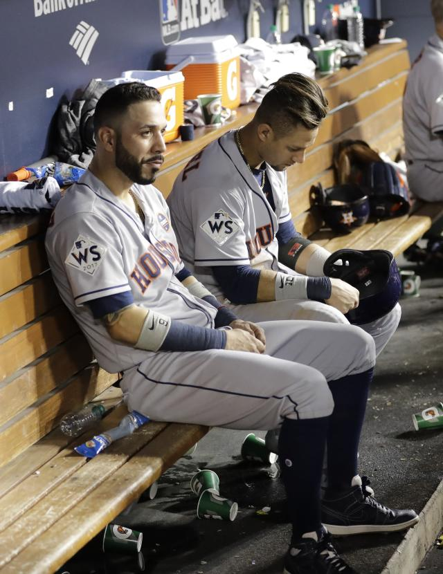<p>Houston Astros' Yuli Gurriel and Marwin Gonzalez sit on the bench during the ninth inning of Game 1 of baseball's World Series against the Los Angeles Dodgers Tuesday, Oct. 24, 2017, in Los Angeles. (AP Photo/David J. Phillip) </p>