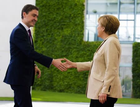 German Chancellor Angela Merkel welcomes Estonia's Prime Minister Taavi Roivas for talks the Chancellery in Berlin