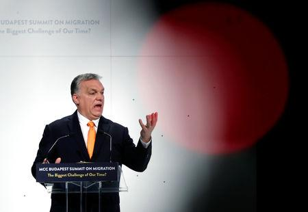 Hungarian Prime Minister Viktor Orban speaks at a migration summit in Budapest