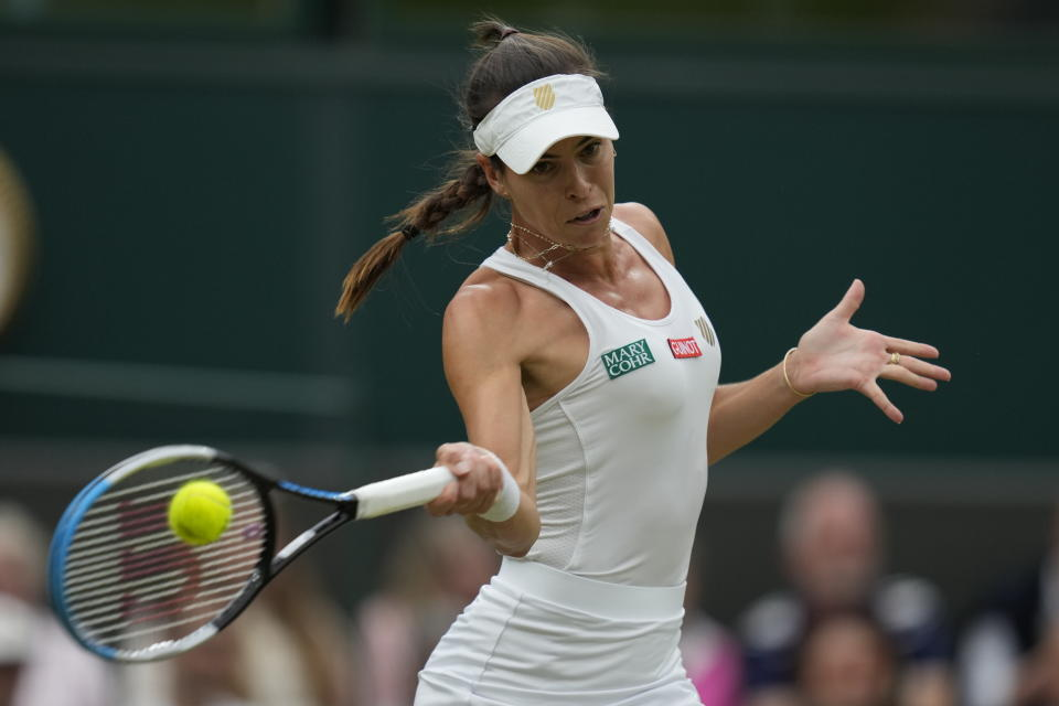 Australia's Ajla Tomljanovic plays a return to compatriot Ashleigh Barty during the women's singles quarterfinals match on day eight of the Wimbledon Tennis Championships in London, Tuesday, July 6, 2021. (AP Photo/Kirsty Wigglesworth)