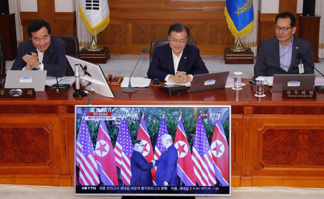 <p>South Korean President Moon Jae-in, center, watches the summit between President Trump and North Korean leader Kim Jong Un before the start of a weekly Cabinet meeting at the presidential Blue House in Seoul, South Korea, on Tuesday. (Photo: Bee Jae-man/Yonhap via AP) </p>