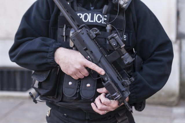 An armed police officer stands guard in London. (Getty)