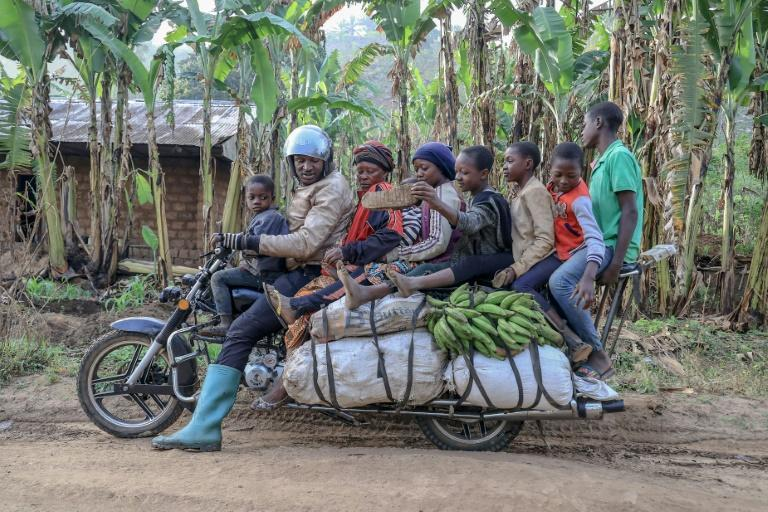 What, no kitchen sink? A giant motorbike in Cameroon takes a driver, six passengers and plenty of luggage
