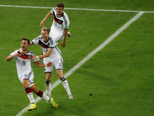 Germany's Mario Goetze, left, celebrates scoring his side's first goal during the World Cup final soccer match between Germany and Argentina at the Maracana Stadium in Rio de Janeiro, Brazil, Sunday, July 13, 2014. (AP Photo/Fabrizio Bensch, Pool)