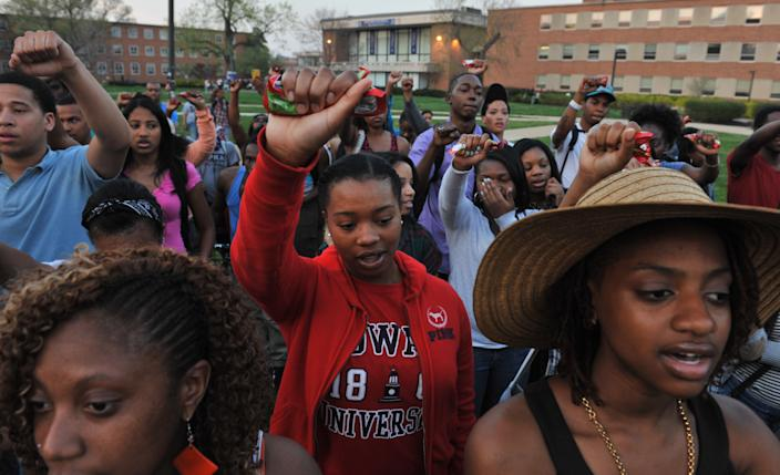 WASHINGTON, DC - MARCH 22: Howard University students held up bags of Skittles as they sang the Negro National Anthem during a vigil for Trayvon Martin on the campus of Howard University on March 22, 2012, in Washington, DC. (Photo by Jahi Chikwendiu/The Washington Post via Getty Images)