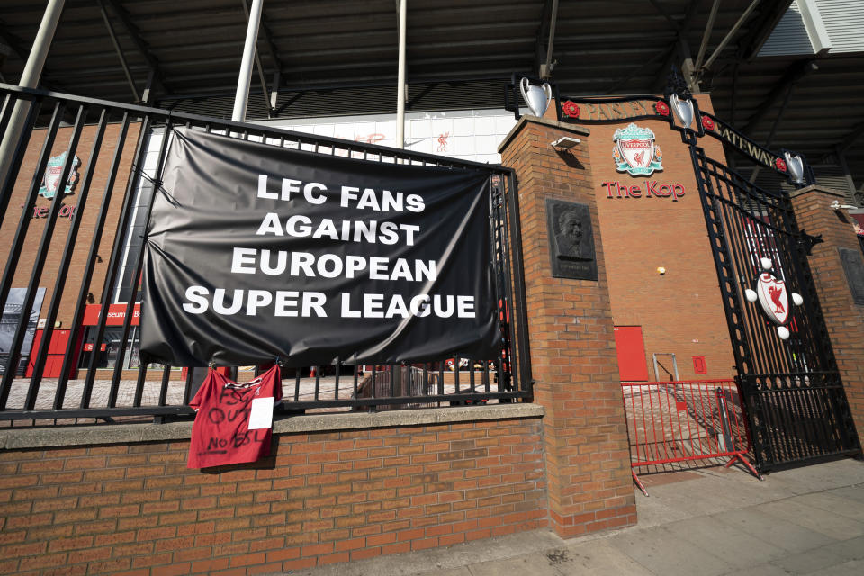 A banner is seen outside Liverpool's Anfield Stadium protesting the formation of the European Super League, Liverpool, England, Monday, April 19, 2021. Players at the 12 clubs setting up their own Super League could be banned from this year's European Championship and next year's World Cup, UEFA President Aleksander Ceferin said Monday. (AP Photo/Jon Super)