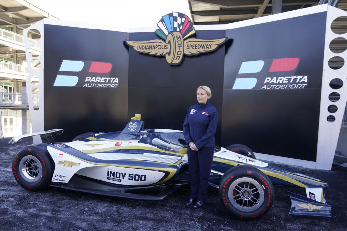 Beth Paretta poses on the victory podium following a news conference at the Indianapolis Motor Speedway, Tuesday, Jan. 19, 2021, in Indianapolis. Paretta and Swiss driver Simona de Silvestro are teaming up to put a women-run race team in this year's Indianapolis 500. (AP Photo/Darron Cummings)
