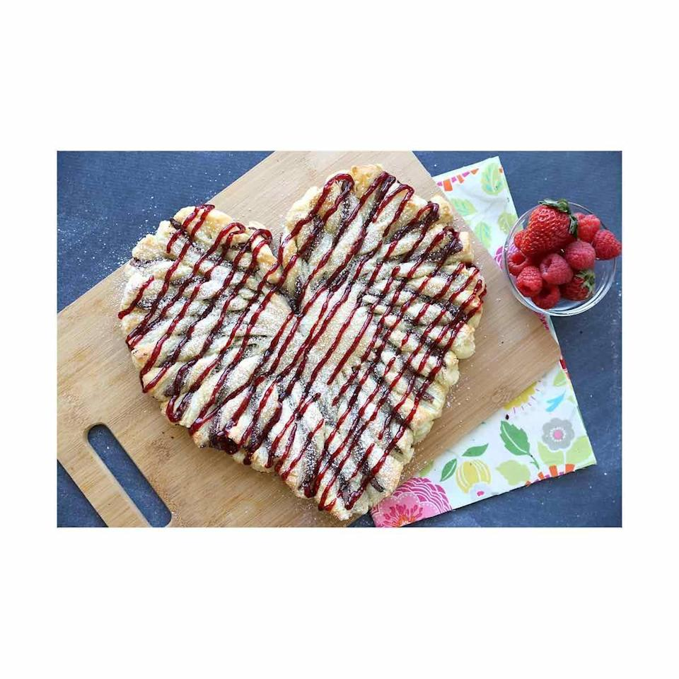 """<p>Though perfect for Valentine's Day, this Nutella-filled pull-apart bread will be a welcome after dinner snack on any winter night. </p><p><a href=""""https://www.itsalwaysautumn.com/raspberry-nutella-puff-pastry-heart-easy-valentines-dessert.html"""" rel=""""nofollow noopener"""" target=""""_blank"""" data-ylk=""""slk:Get the recipe"""" class=""""link rapid-noclick-resp"""">Get the recipe</a>.</p>"""