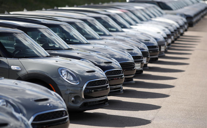FILE - In this Aug. 25, 2019, file photo, a long line of unsold Clubman sports-utility vehicles sit at a Mini dealership in Highlands Ranch, Colo. On Friday, Sept. 13, the Commerce Department releases U.S. retail sales data for August. (AP Photo/David Zalubowski, File)