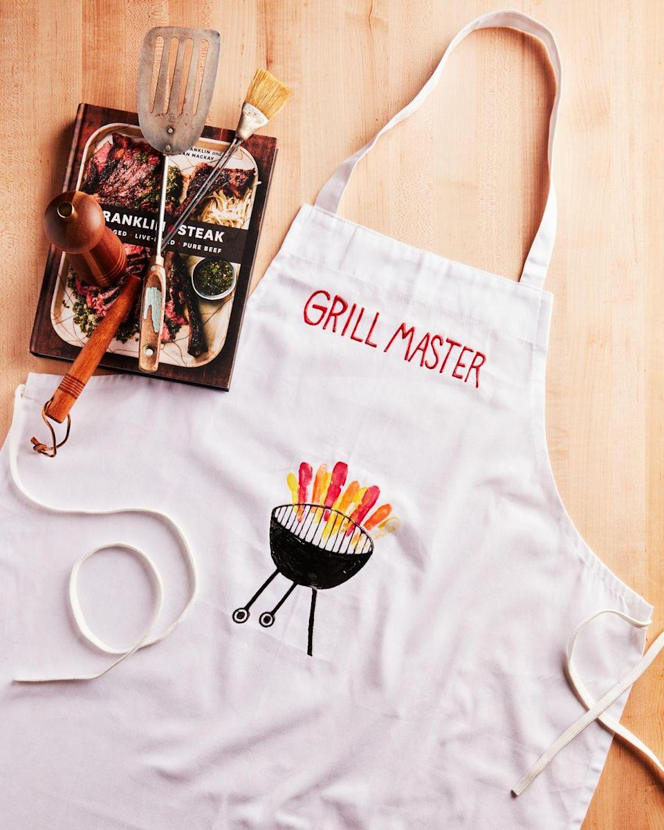 """<p>The ideal gift for the dad who loves to spend time outback barbecuing a delicious meal for friends and family. <br><strong><br>To make:</strong> Use fabric markers or fabric paint and a small paint brush to paint """"grill master"""" and a grill on a plain canvas apron. Once dry, have kids dip their pinky fingers in orange, red, and yellow paint and press onto apron, just above grill grates, to create flames.<br><br><a class=""""link rapid-noclick-resp"""" href=""""https://www.amazon.com/Fabric-Permanent-DAPAWIN-Markers-Clothes/dp/B08DJ66863/ref=sr_1_1_sspa?tag=syn-yahoo-20&ascsubtag=%5Bartid%7C10050.g.1171%5Bsrc%7Cyahoo-us"""" rel=""""nofollow noopener"""" target=""""_blank"""" data-ylk=""""slk:SHOP MARKERS"""">SHOP MARKERS</a></p>"""