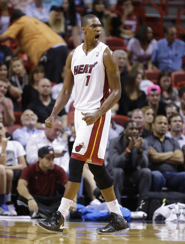 Miami Heat center Chris Bosh reacts to a call during the first half of an NBA basketball game against the Dallas Mavericks, Friday, Nov. 15, 2013, in Miami. (AP Photo/Wilfredo Lee)