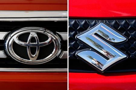 The logos of Toyota (R) and Suzuki are pictured. REUTERS/Erik De Castro/Mike Blake
