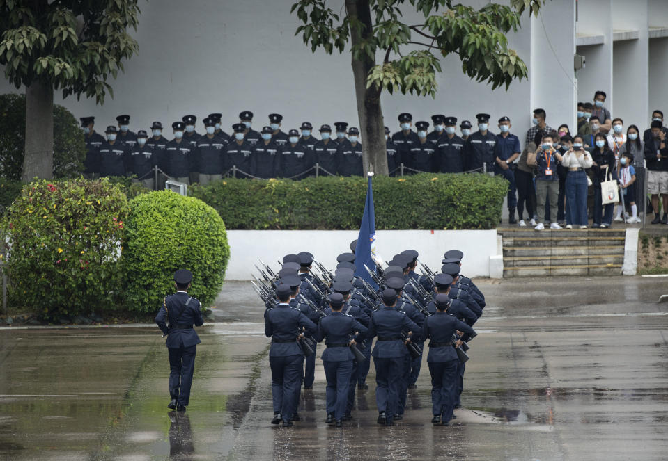 "Hong Kong police match on the National Security Education Day at a police school in Hong Kong Thursday, April 15, 2021. Beijing's top official in Hong Kong on Thursday warned foreign forces not to interfere with the ""bottom line"" of national security in Hong Kong, threatening retaliation even amid ongoing tensions between China and Western powers.(AP Photo/Vincent Yu)"