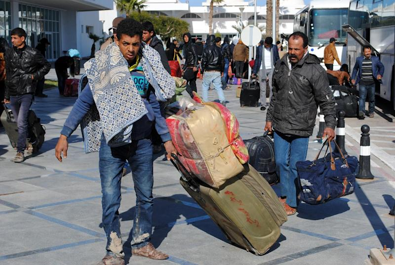 Egyptians, who were formerly residing in Libya, arrive at Djerba airport on the Tunisian-Libyan border, for a flight evacuating them to Cairo, on February 23, 2015 (AFP Photo/Fethi Nasri)