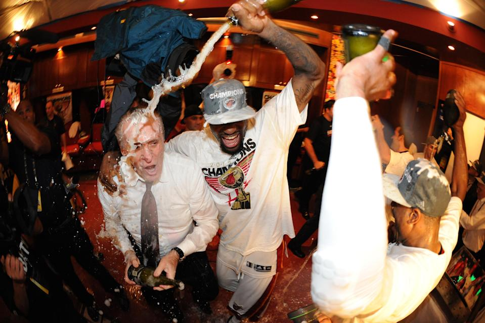 LeBron James showers Miami Heat president Pat Riley in champagne after they won the 2012 NBA title. (Getty Images)
