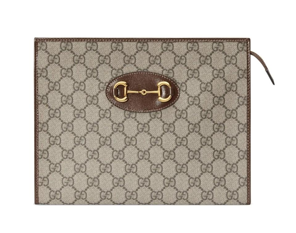 <p>You can't go wrong with this <span>Gucci 1955 Horsebit GG Supreme Canvas Pouch</span> ($890).</p>